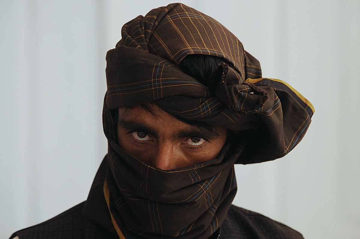 A former Taliban fighter looks on after he joined Afghan government forces during a ceremony in Herat on on June 26, 2013.
