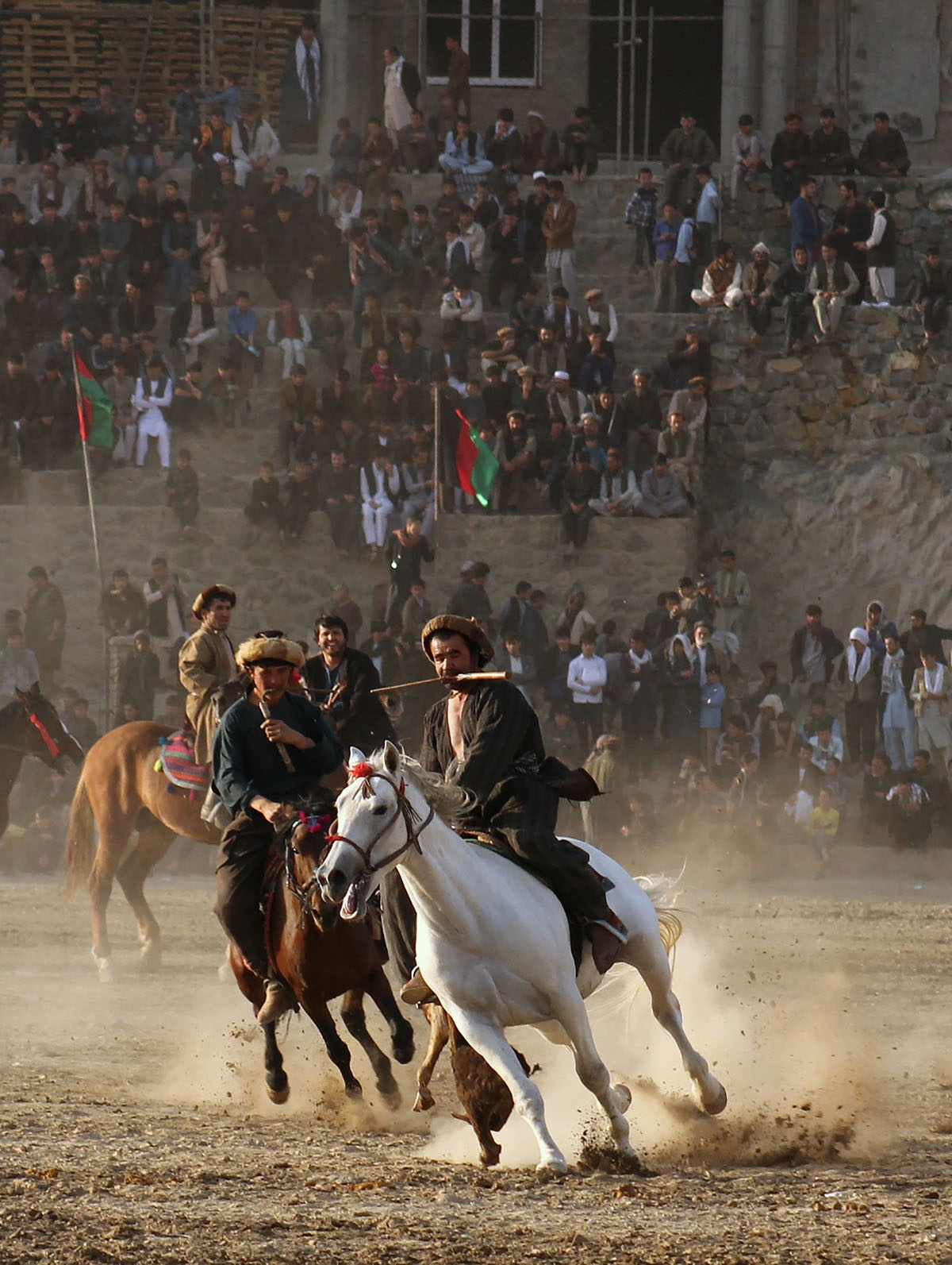 In this photograph taken on November 7, 2017 Afghan horsemen compete in the traditional sport of Buzkashi in Badakhshan province.
