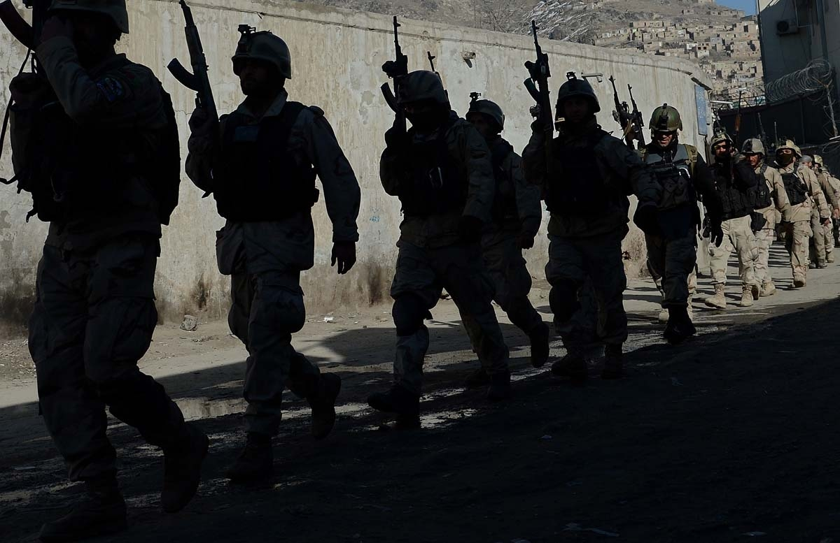 In this file photo taken on January 21, 2013 Afghan commandos walk down a road  near the Kabul police headquarters building after a clash between Afghanistan forces and Taliban fighters in Kabul.