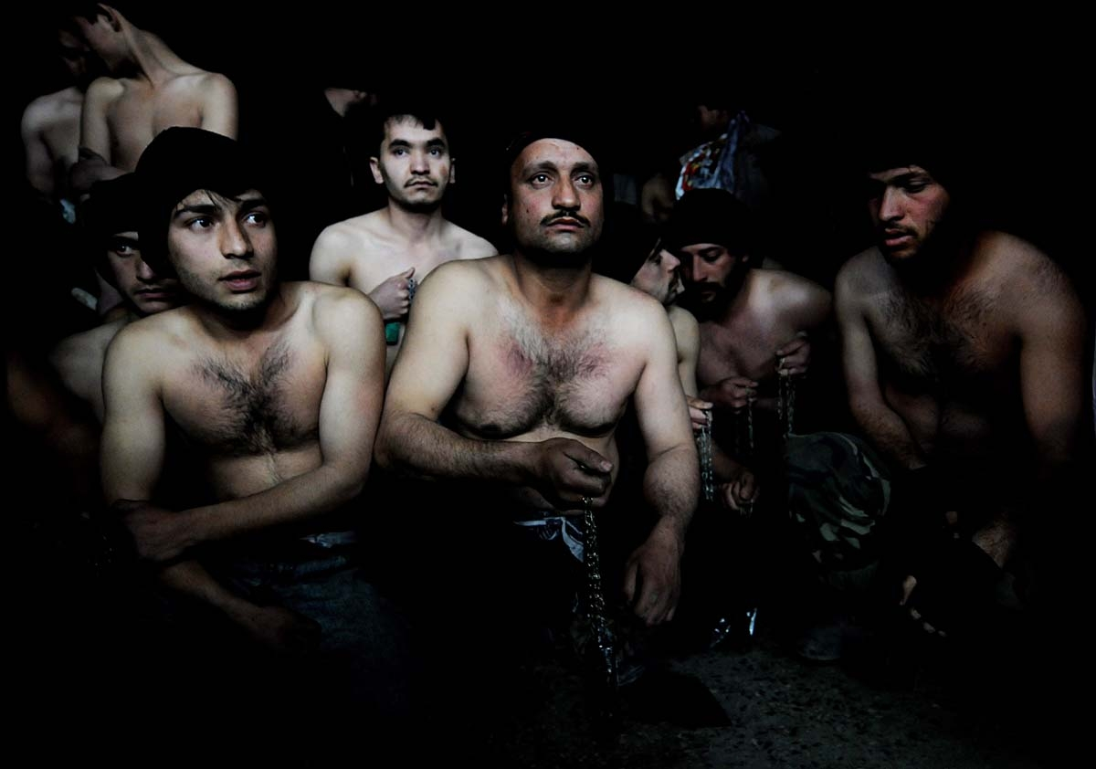 (FILES) In this file photo taken on January 15, 2008 Afghan men hold chains as they wait to take part in ritual self-flagellation to celebrate the Muslim festival of Ashura, at a mosque in Kabul.