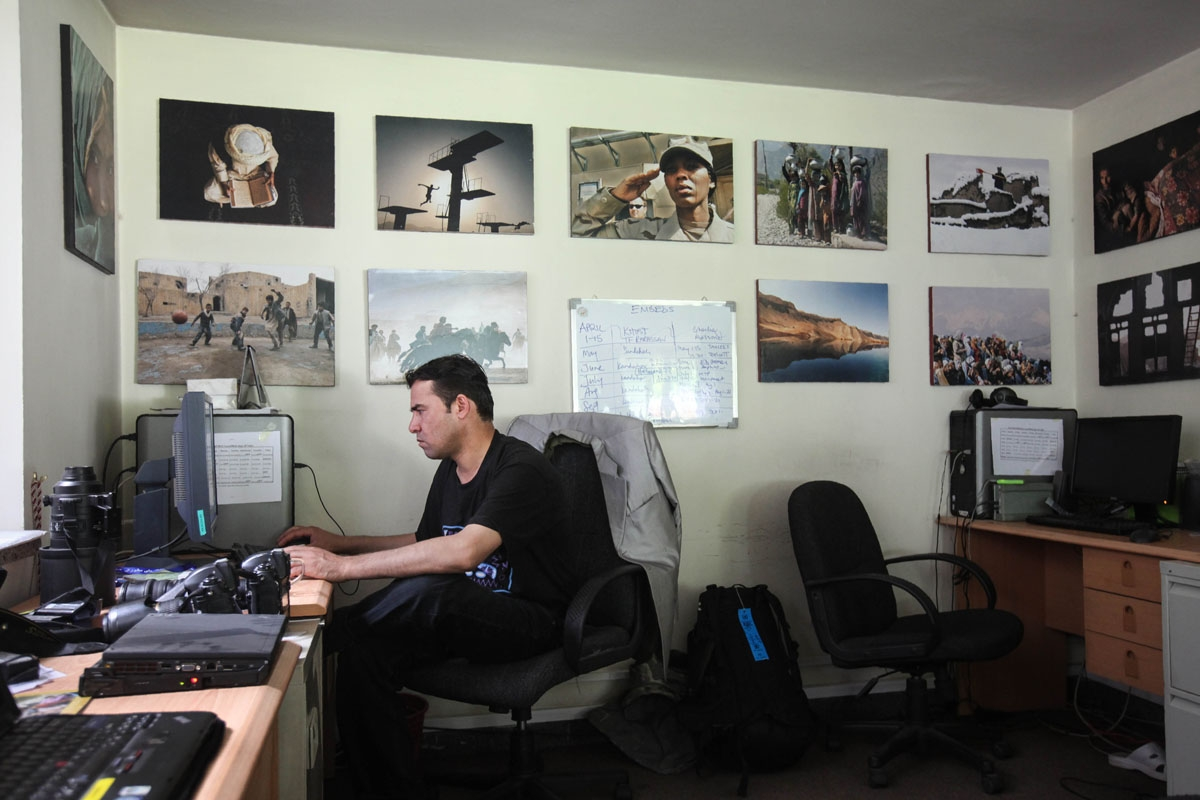 In this photo taken on June 17, 2010, Agence France-Presse (AFP) chief photographer for Afghanistan Shah Marai sits at his desk at the AFP office in Kabul.