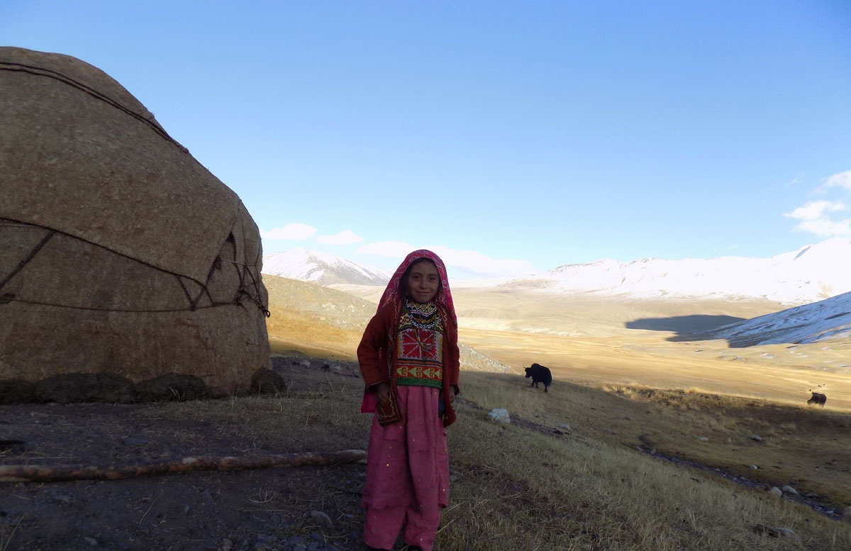 This picture taken on October 8, 2017 shows a Kyrgyz girl standing outside her traditional yurt in the Wakhan Corridor in Afghanistan.