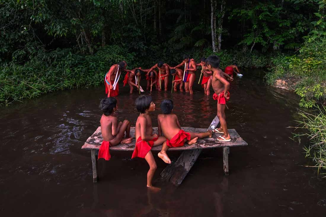 Waiapi men dance and play flute during the Anaconda's party -during which they make flutes to play and dance, and at the end leave all flutes on the river for the Anaconda snake to protect their village- in the Waiapi indigenous reserve in Amapa state in