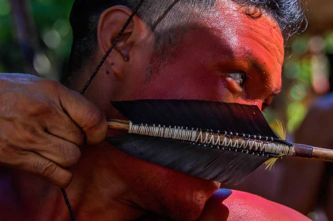 A Waiapi man uses his bow and arrow at the Pinoty village at the Waiapi indigenous reserve on Amapa state, in Brazil, on October 12, 2017.