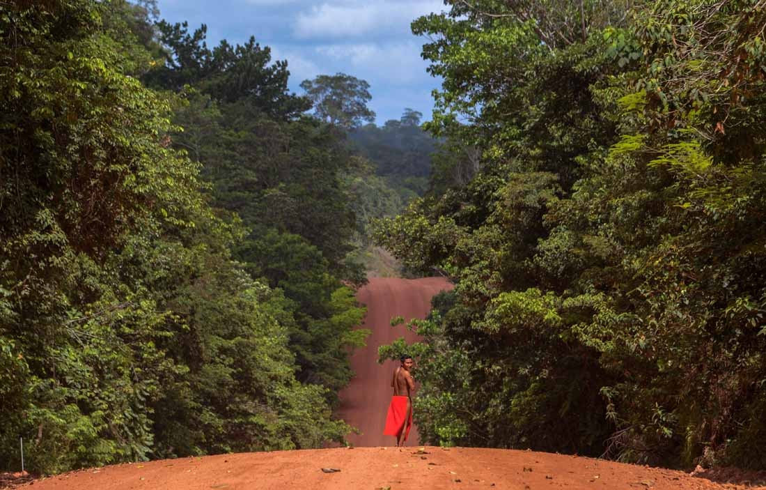 A Waiapi man walks on the road in the Waiapi indigenous reserve in Amapa state in Brazil on October 15, 2017.