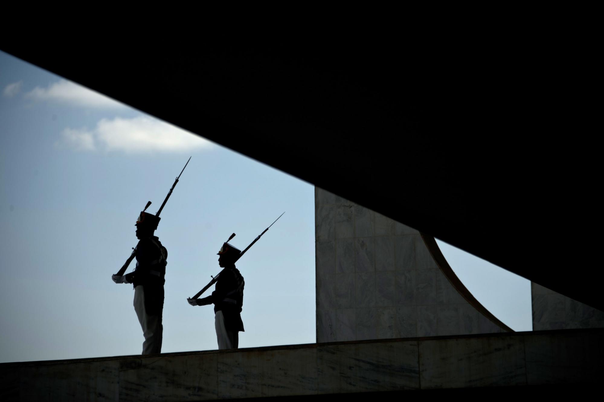 Presidential protocol guards are silhouted at the Planalto palace in Brasilia on May 11, 2016