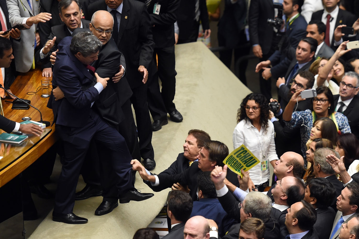 Brazilian Deputies fight during a session to discuss the admissibility of the impeachment request of President Dilma Rousseff in Brasilia on April 17, 2016.