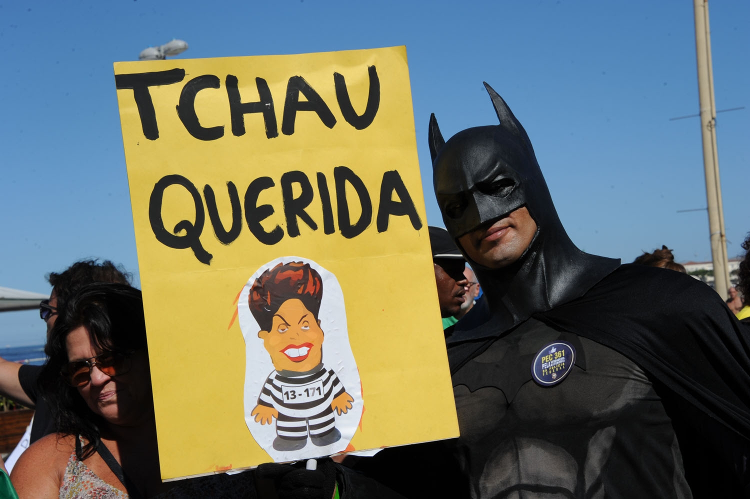 A man disguised as Batman holds a sign reading Bye Darling during a  protest in favor of impeachment of President Dilma Rousseff in Copacabana, Rio de Janeiro, Brazil on April 17, 2016.