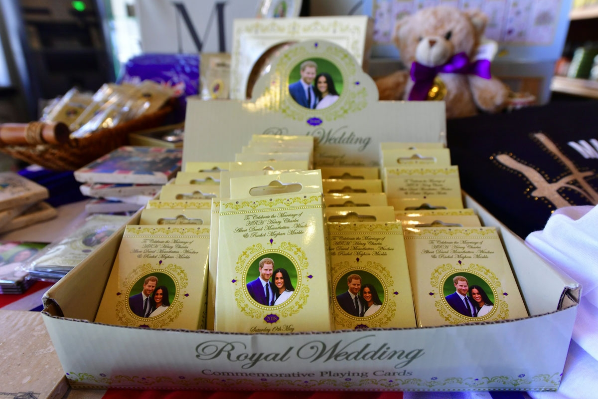 Decks of playing cards are displayed among a selection of royal wedding merchandise at Ye Olde Kings Head gift shop in Santa Monica, California on May 14, 2018, where royal wedding merchandise with pictures of Prince Harry and Meghan Markle have been sell