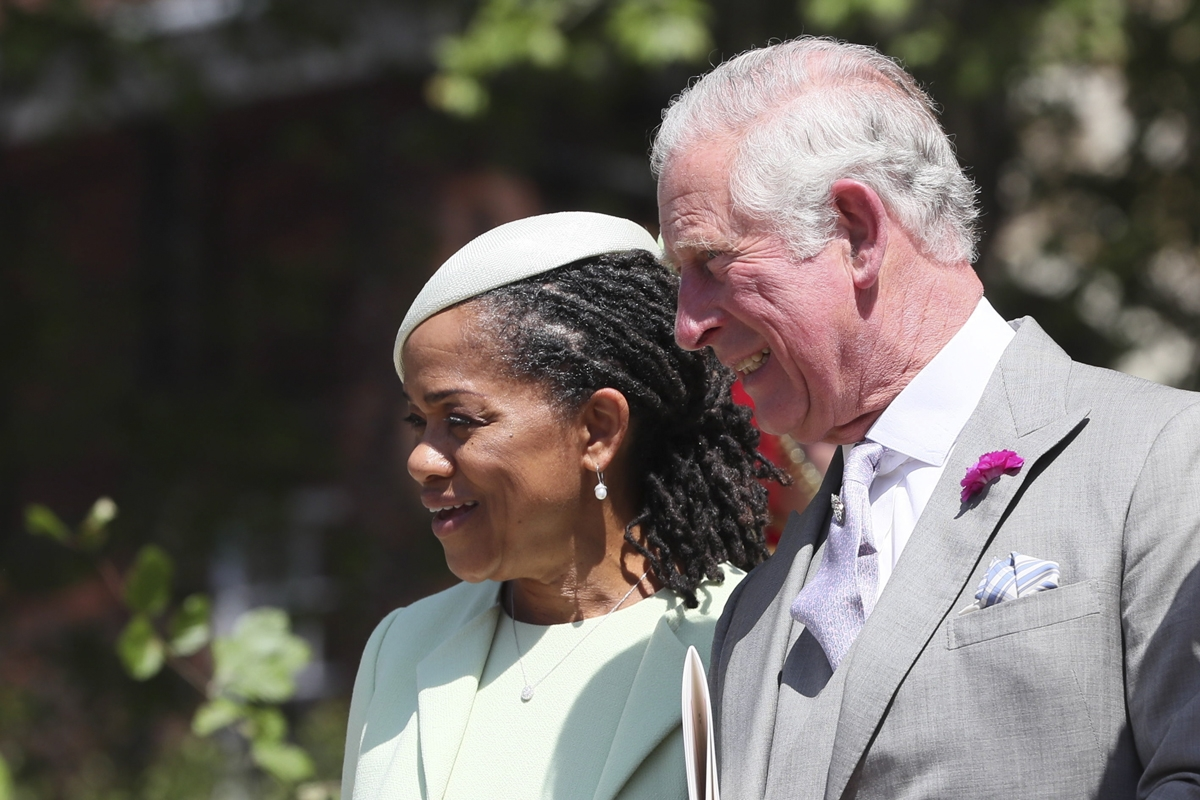 Meghan Markle's mother Doria Ragland (L) and Prince Harry's father Britain's Prince Charles, Prince of Wales (R) leave after attending the wedding ceremony of Britain's Prince Harry, Duke of Sussex and US actress Meghan Markle at St George's Chapel, Winds