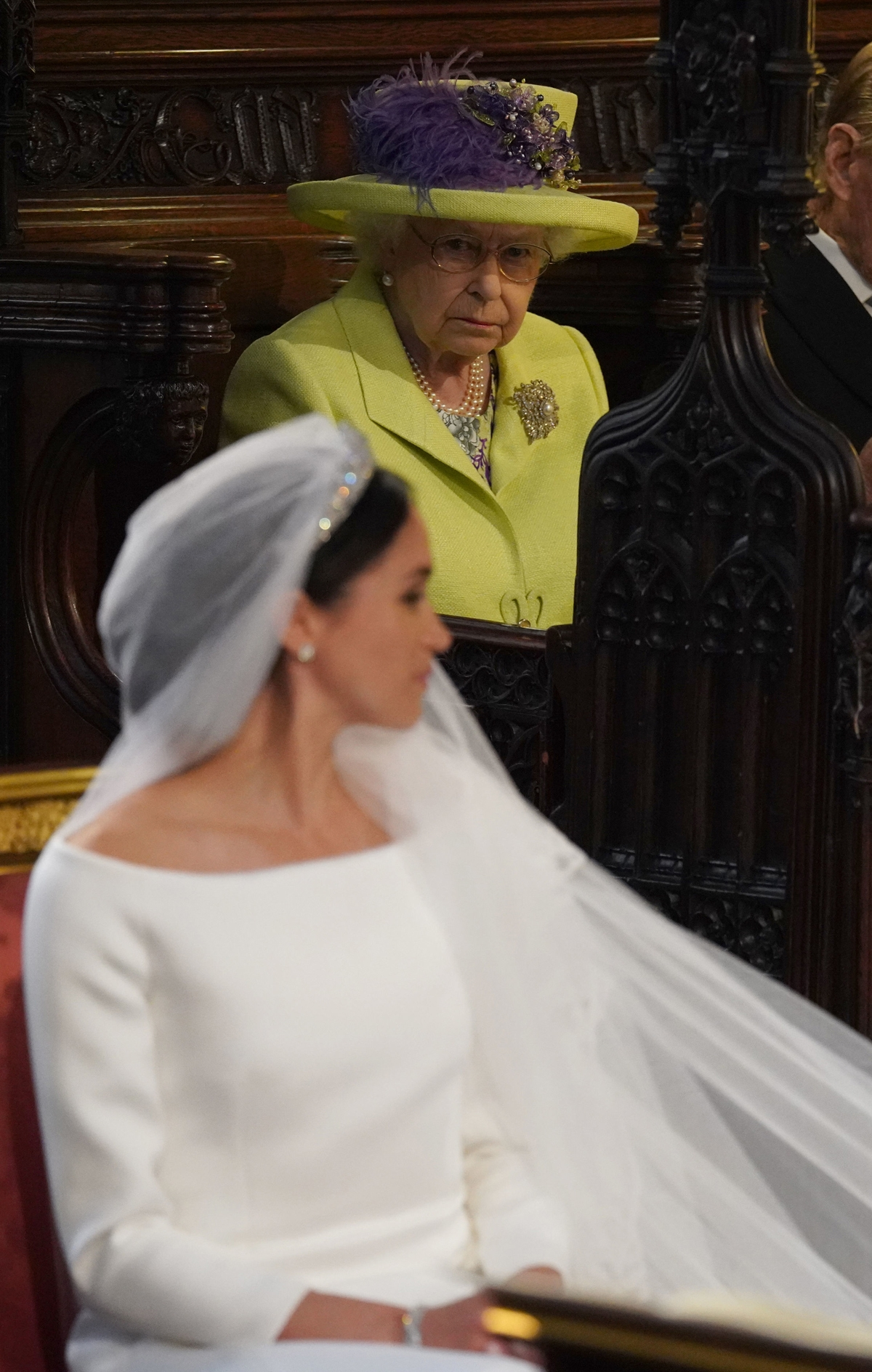 Britain's Queen Elizabeth II looks on during the wedding ceremony of Britain's Prince Harry, Duke of Sussex and US actress Meghan Markle in St George's Chapel, Windsor Castle, in Windsor, on May 19, 2018. / AFP PHOTO / POOL / Jonathan Brady