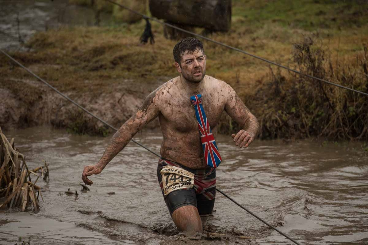 A competitor takes part in the 'Tough Guy' adventure race near Wolverhampton, central England, on January 29, 2017.  The Tough Guy event, which is being held for the final time in its 30th year, challenges thousands of competitors to run a gruelling cours