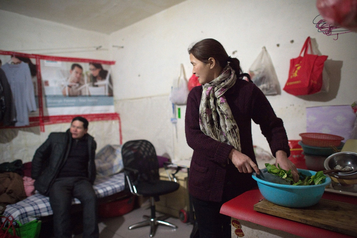 This picture taken on February 16, 2017 shows Mr and Mrs Yang (given names not available) inside their 9 square metres room in the Heiqiaocun migrant village in Beijing.