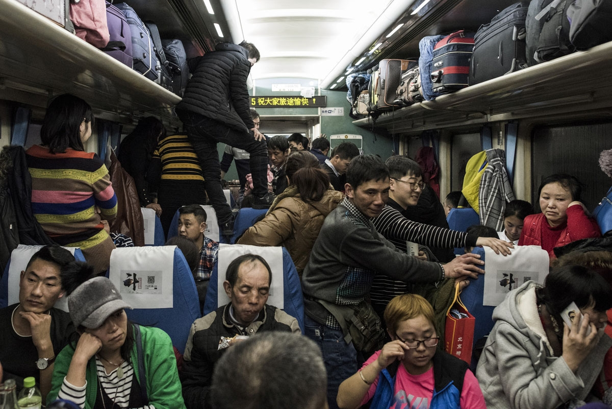 This photo taken on February 10, 2018 shows passengers travelling on a crowded train during the 26-hour journey from Beijing to Chengdu, in Shijiazhuang, as they head home ahead of the Lunar New Year.