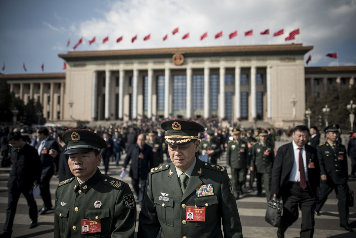Military delegates leave the Great Hall of the People at the end of the opening of the National People's Congress in Beijing on March 5, 2017.