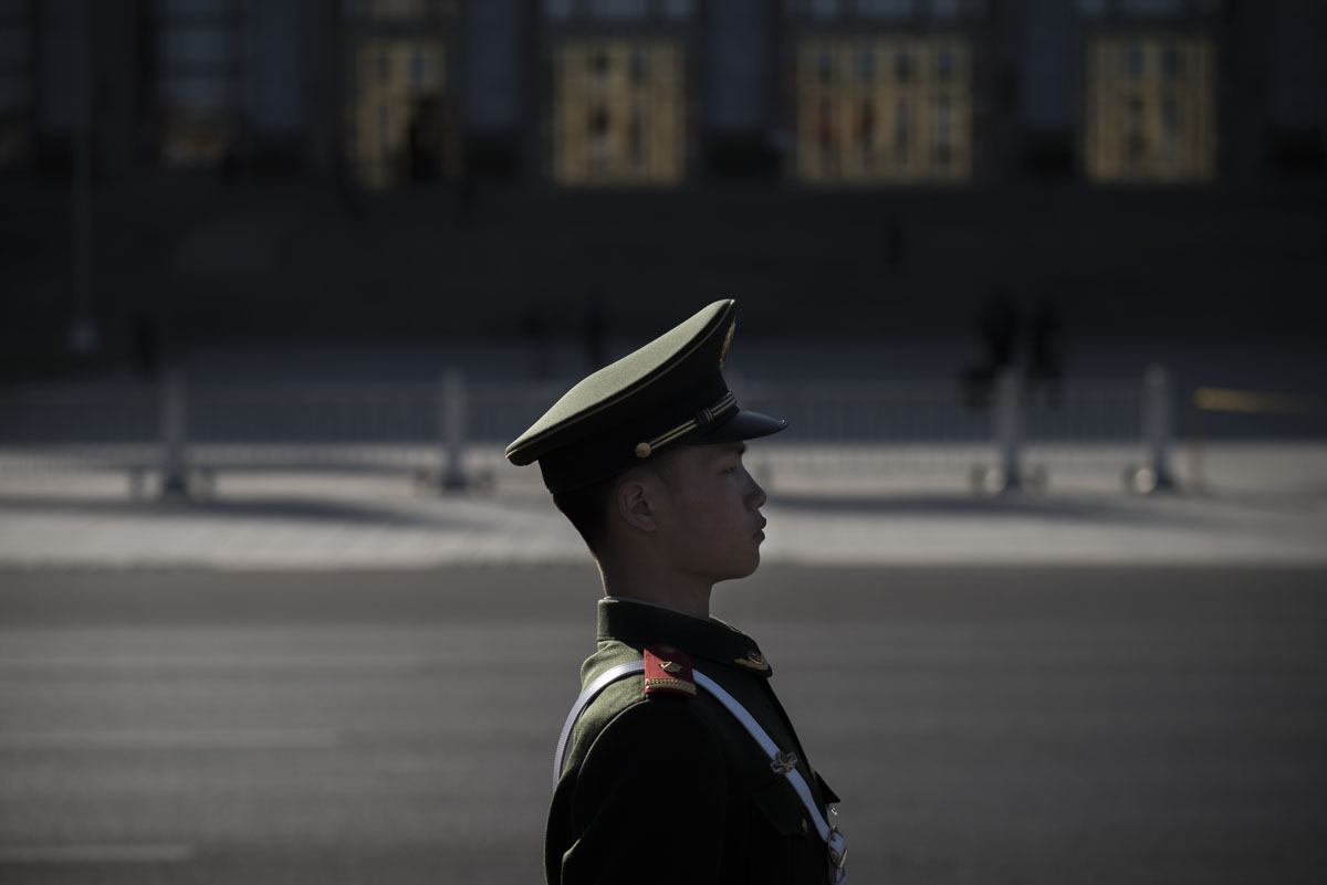 A paramilitary guard stands during the Chinese People's Political Consultative Conference plenary session at the Great Hall of the People in Beijing on March 9, 2017.