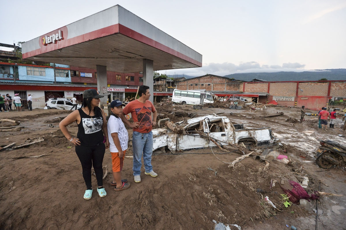 People look at the damage caused by mudslides following heavy rains in Mocoa, Putumayo department, southern Colombia on April 1, 2017.