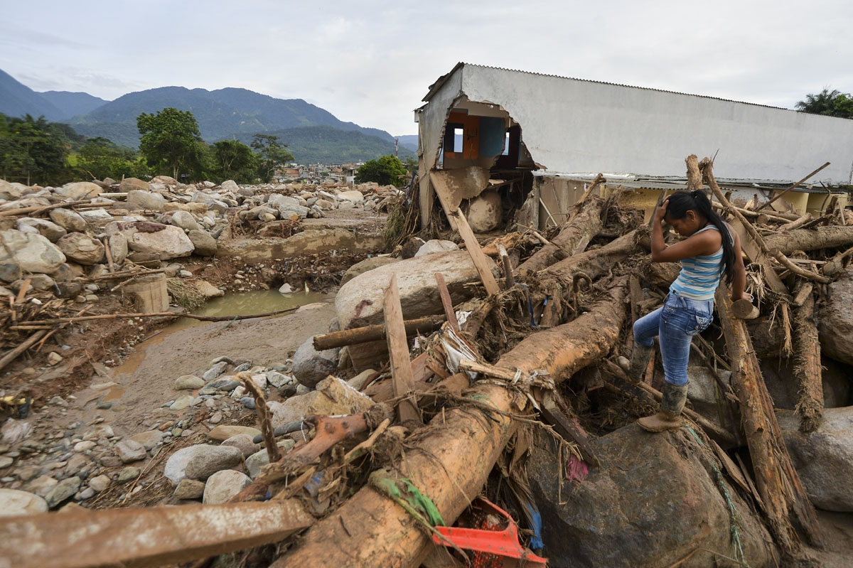 A woman gestures amid the damage caused by mudslides following heavy rains in Mocoa, Putumayo department, southern Colombia on April 2, 2017.