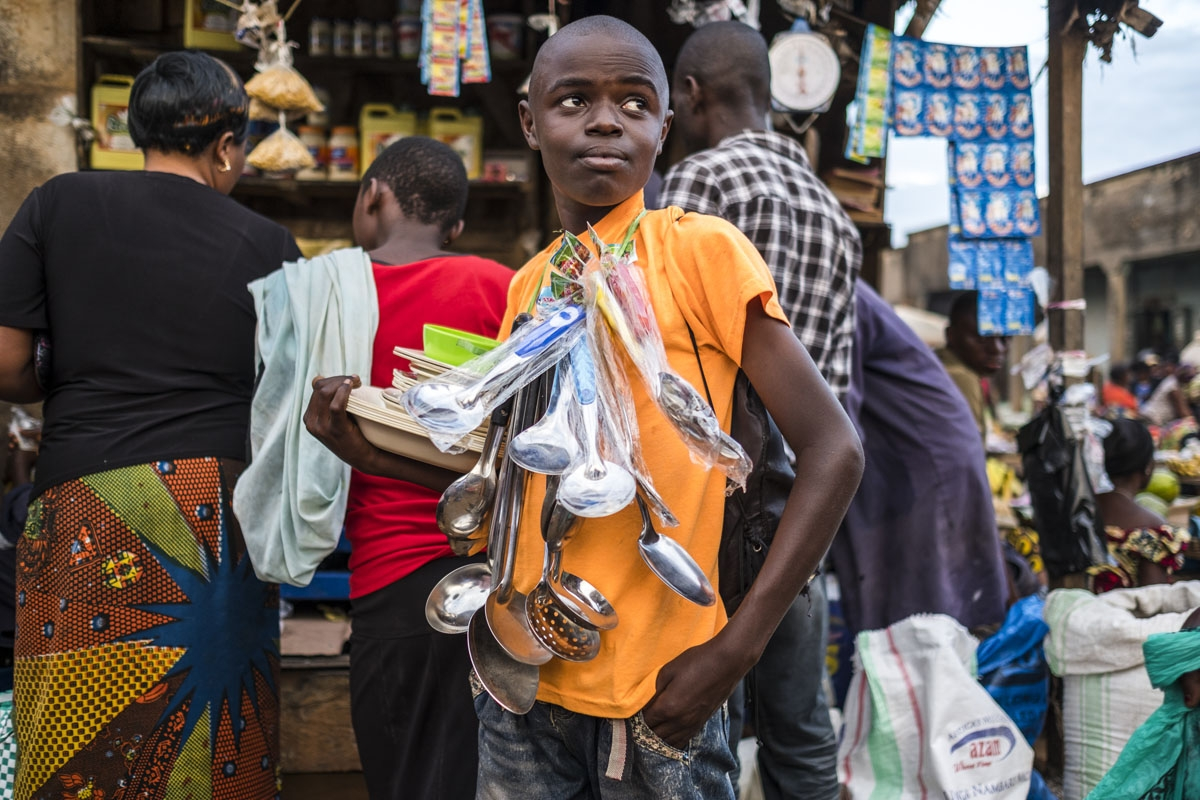 A boy sells kitchen ware at a market in Beni on November 9, 2016.