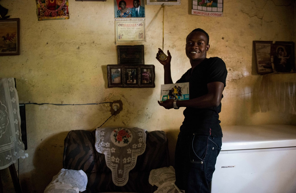 This photograph taken on May 15, 2017, shows Prince Kasongo, a member of the Katumbi Football Academy, showing his awards at his house in Lubumbashi, DR Congo.