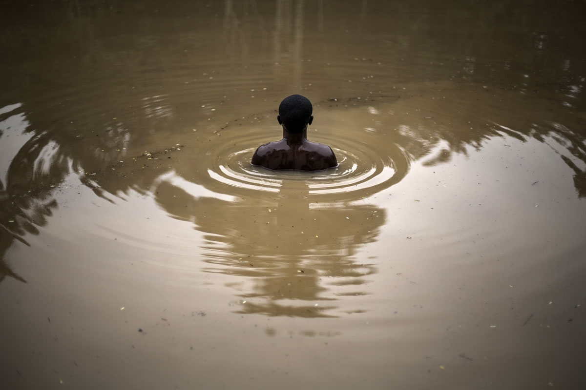 member of the Kimbanguist church submerges himself three times in the holy water to cleanse himself on May 24, 2017 in Nkamba.