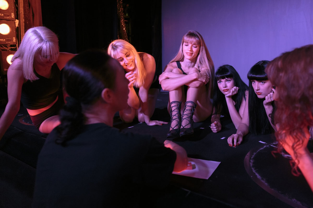 Dancers listen to stage and production director, Svetlana Konstantinova, on the stage of the Parisian cabaret Crazy Horse on September 15, 2017 in Paris.
