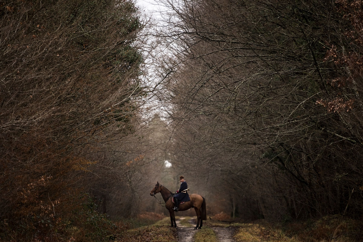 A hunter rides his horse during a hunting with hounds on December 23, 2017 in the forest near Chatenoy, center France.