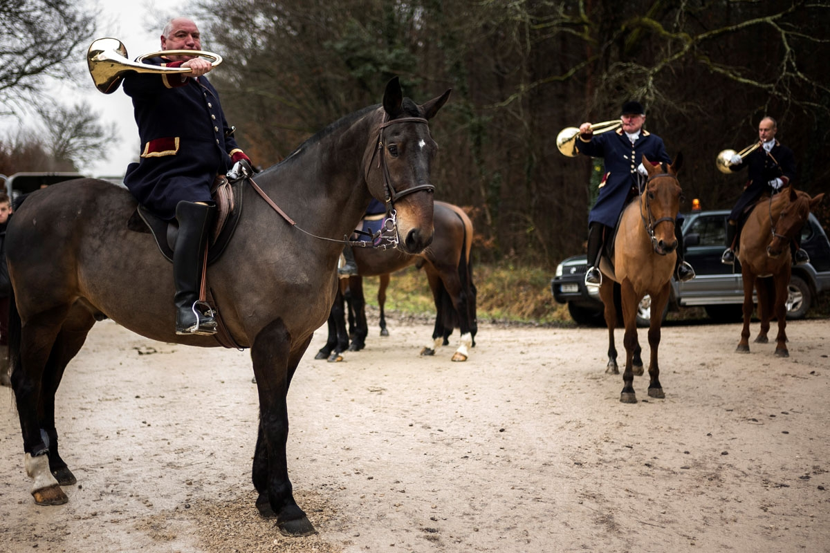 Pierre-Francois Prioux (L), founder of the Rallye Tempete rides his horse during a hunting with hounds on December 23, 2017 in the forest near Chatenoy, center France.