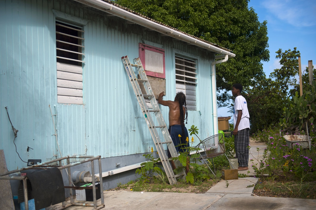 People put boards on their windows as part of preparations for arrival of Hurricane Irma on September 5, 2017 in Marigot, on the French overseas island of Saint-Martin.