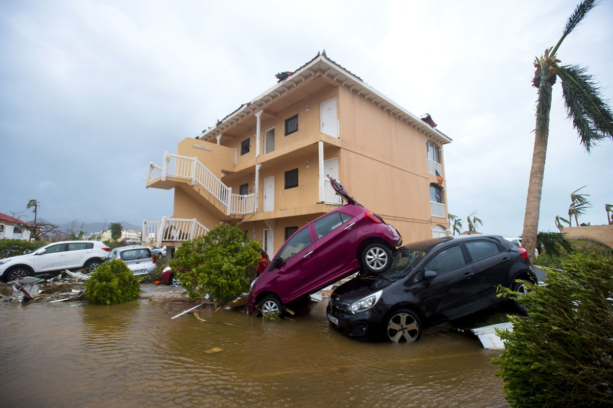A photo taken on September 6, 2017 shows cars piled on top of one another in Marigot, near the Bay of Nettle, on the French Collectivity of Saint Martin, after the passage of Hurricane Irma.