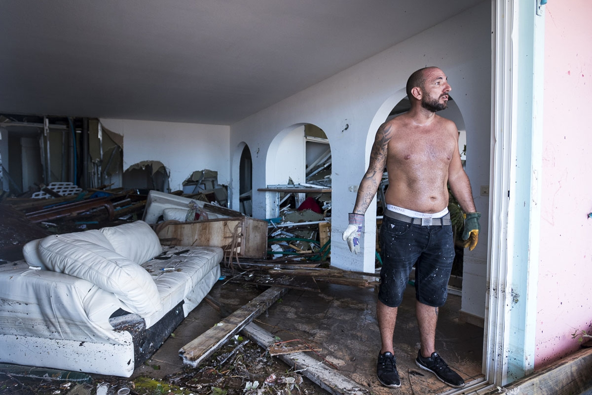 A man reacts as stands  in his destroyed home   on September 7, 2017 in Orient Bay on the French Carribean island of Saint-Martin, after the passage of Hurricane Irma.