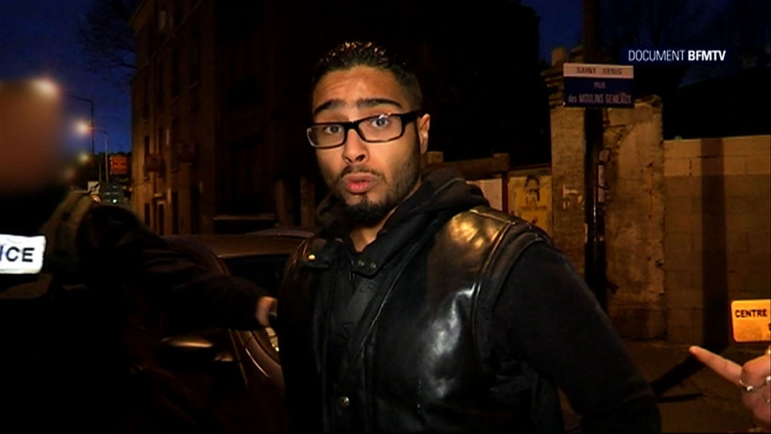 A image grab made from a handout video taken on November 18, 2015 and released on November 25, 2015 by BFMTV shows Jawad Bendaoud, the man who allegedly lent his Paris suburb apartment to the suspected ringleader of the attacks on Paris, being arrested in