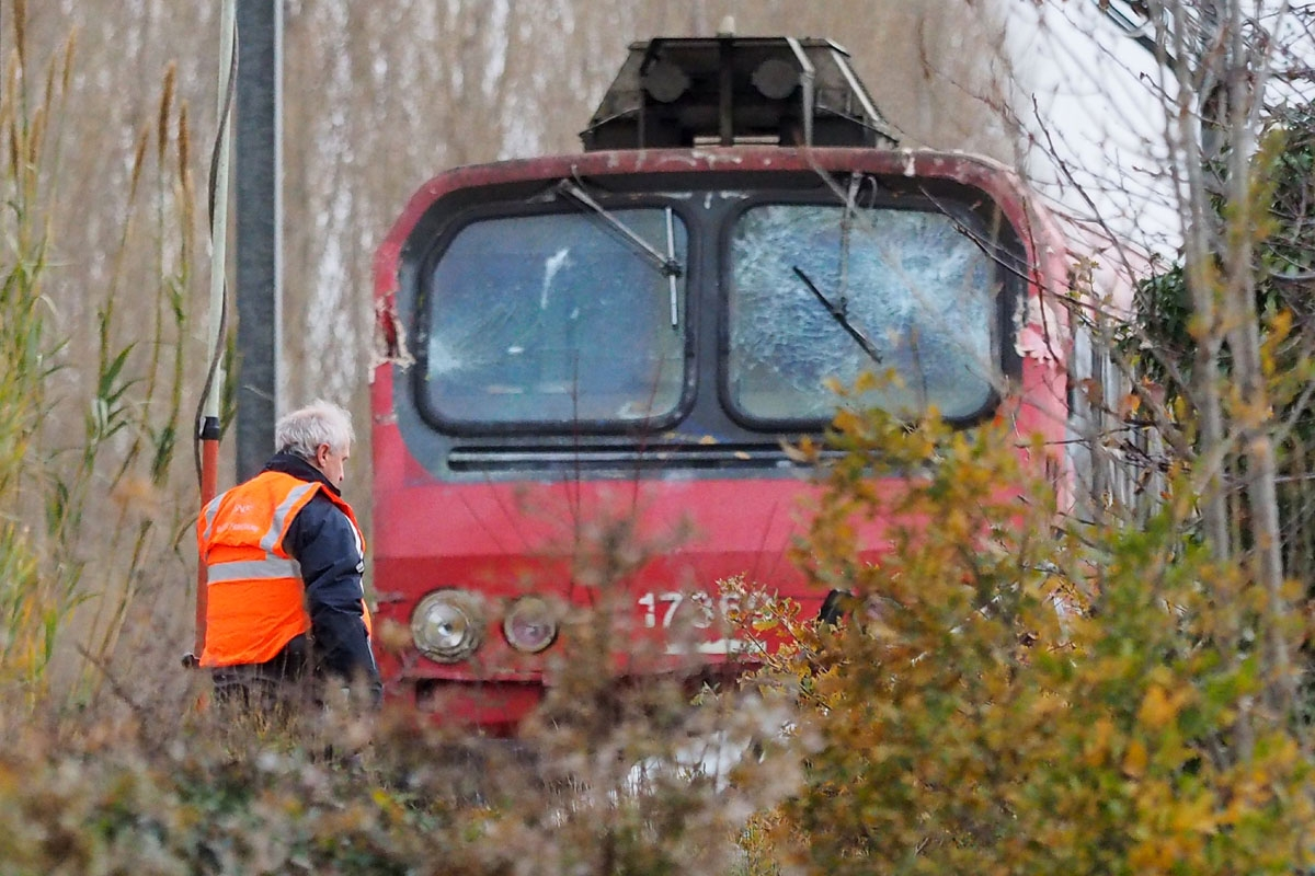 A SNCF worker inspects the front of a regional TER train that crashed into a school bus in Millas, near Perpignan, southern France, on December 15, 2017, a day after the accident at a level crossing.