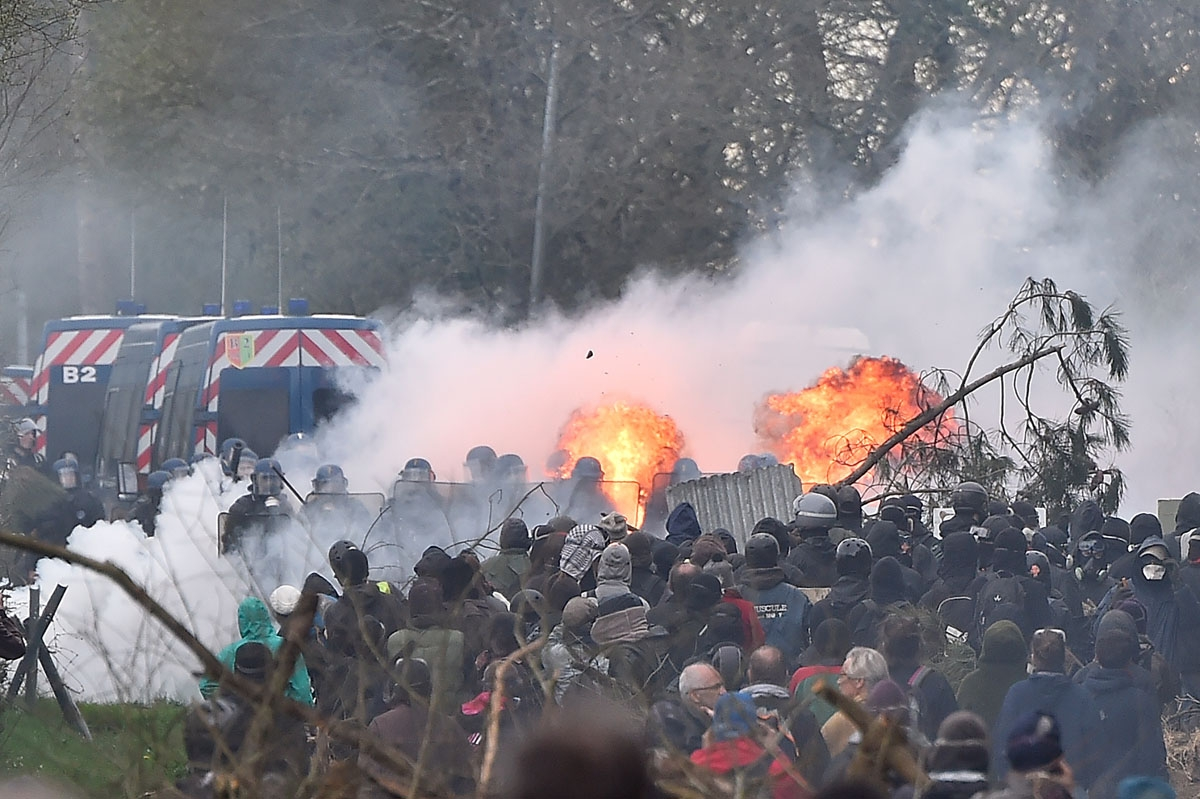 Protesters and gendarmes clash  on April 11, 2018, during a police operation to raze the decade-old anti-capitalist camp known as ZAD (Zone a Defendre - Zone to defend) set up to protest a new airport in Notre-Dame-des-Landes, near the western French city