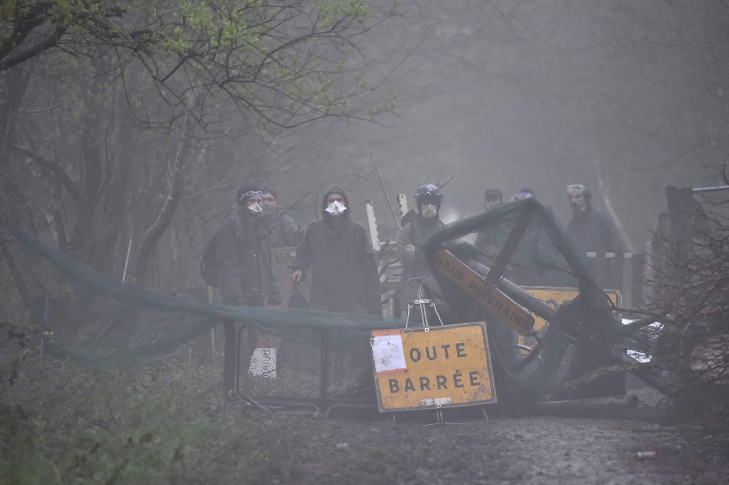 Protesters set up a barricade to block a path during an operation to clear an area known as ZAD (Zone a Defendre - Zone to defend) of environmental protesters occupying the site of what had been a proposed new airport in Notre dame des Landes on April 10,