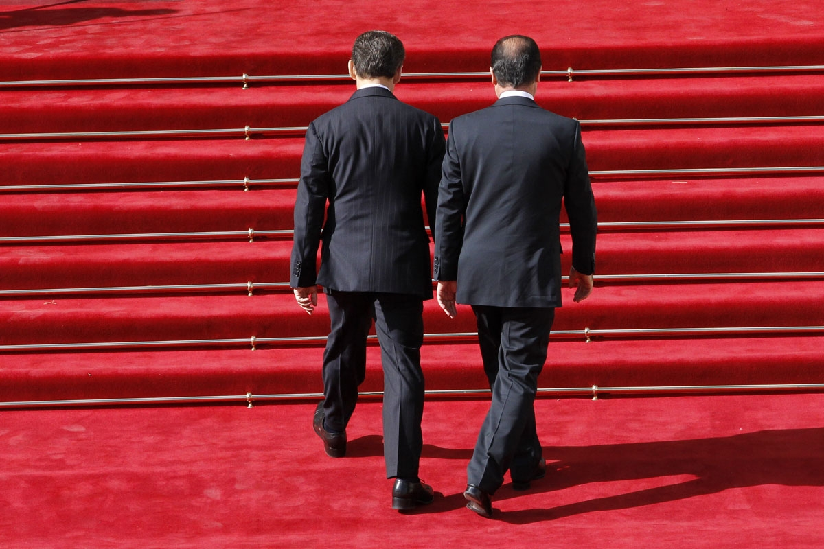 France's president Nicolas Sarkozy (L) welcomes his successor Francois Hollande upon his arrival at the Elysee Palace for the formal investiture ceremony between France's president Francois Hollande and his predecessor Nicolas Sarkozy, at the Elysee presi