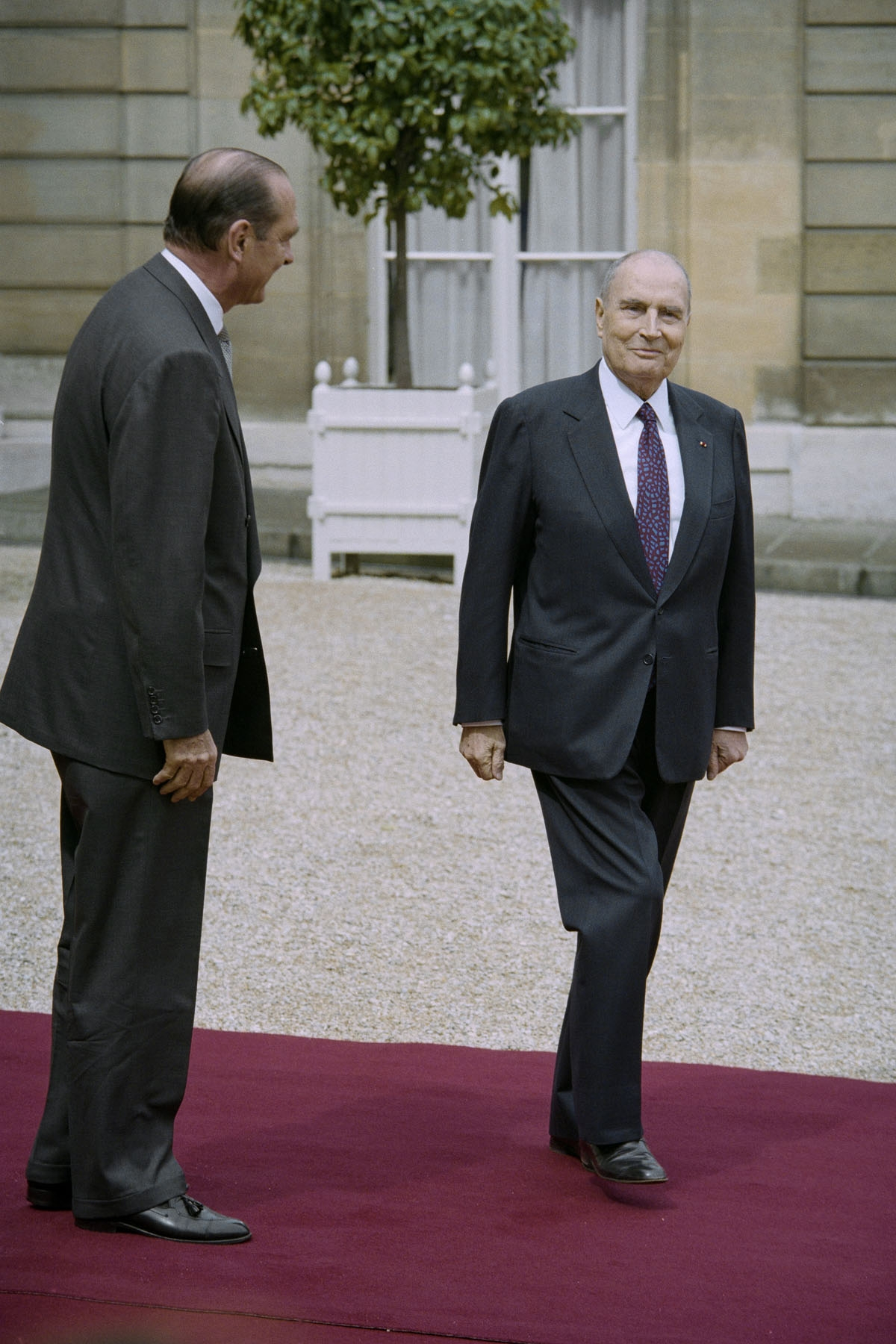 French outgoing President Francois Mitterrand (R) is escorted by his successor Jacques Chirac as he leaves the Elysee Palace during the formal handover of power ceremony on May 17, 1995 in Paris.