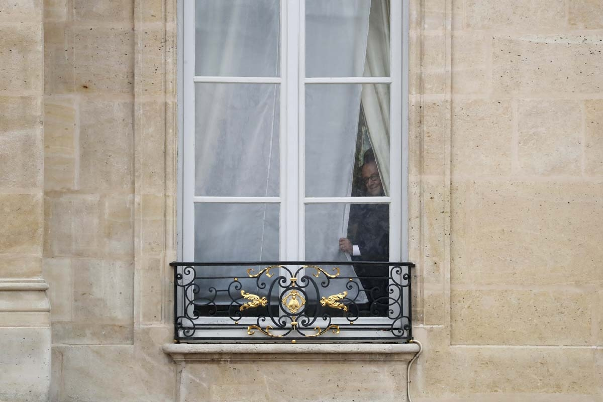 French outgoing president Francois Hollande looks out from a window of the Elysee presidential Palace prior to his successor's formal inauguration ceremony as French President on May