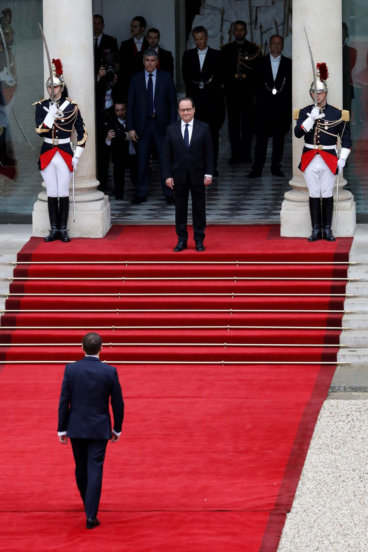French newly elected President Emmanuel Macron is welcomed by his predecessor Francois Hollande (top C) as he arrives at the Elysee presidential Palace for the handover and inauguration ceremonies on May 14, 2017 in Paris.