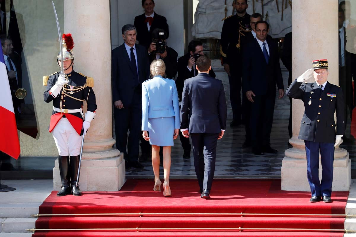 French newly elected President Emmanuel Macron (R) walks next to his wife with his wife Brigitte Trogneux at the Elysee presidential Palace before his formal