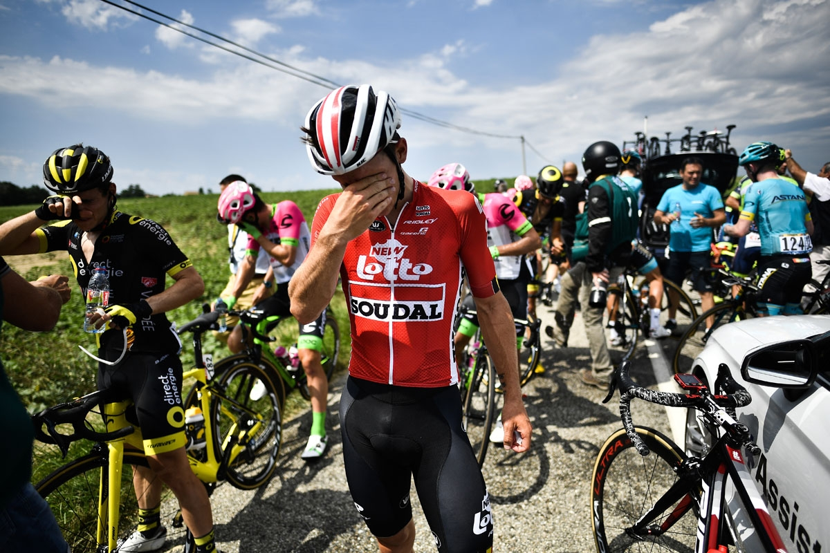 Riders clean their stinging eyes after tear gas was used during a farmers' protest who attempted to block the stage's route, during the 16th stage of the 105th edition of the Tour de France cycling race, between Carcassonne and Bagneres-de-Luchon, southwe