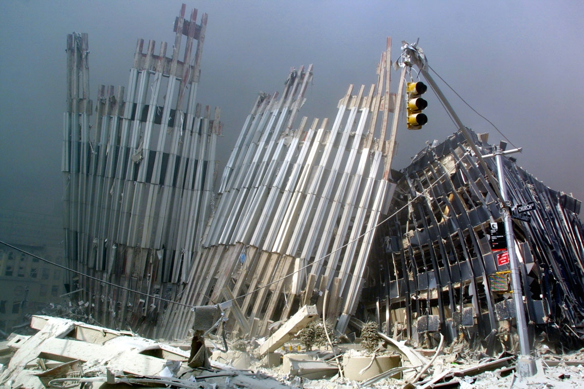 A part of a tower can be seen after the collapse of the first World Trade Center Tower 11 September, 2001 in New York.