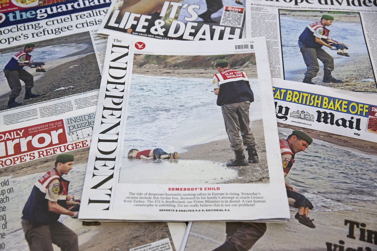The front pages of some of Britain's daily newspapers showing an image of the body of Syrian three-year-old boy Aylan are pictured in London, on September 3, 2015. Th