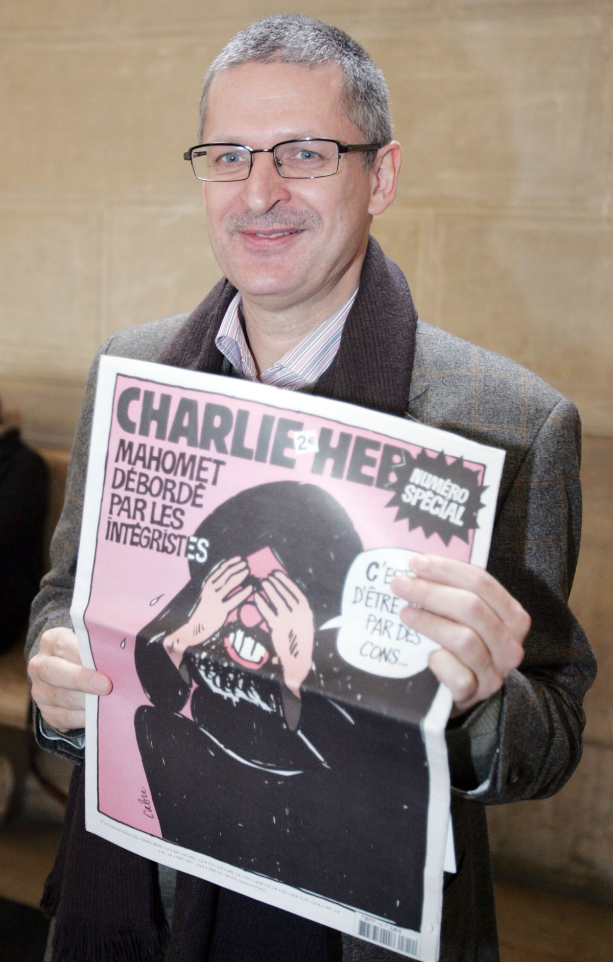 Culture editor of the Danish newspaper Jyllands-Posten, Fleming Rose shows French satirical weekly Charlie Hebdo 07 February 2007 at the Paris court to attend the trial of French satirical weekly Charlie Hebdo chief editor Philippe Val trial on the case b