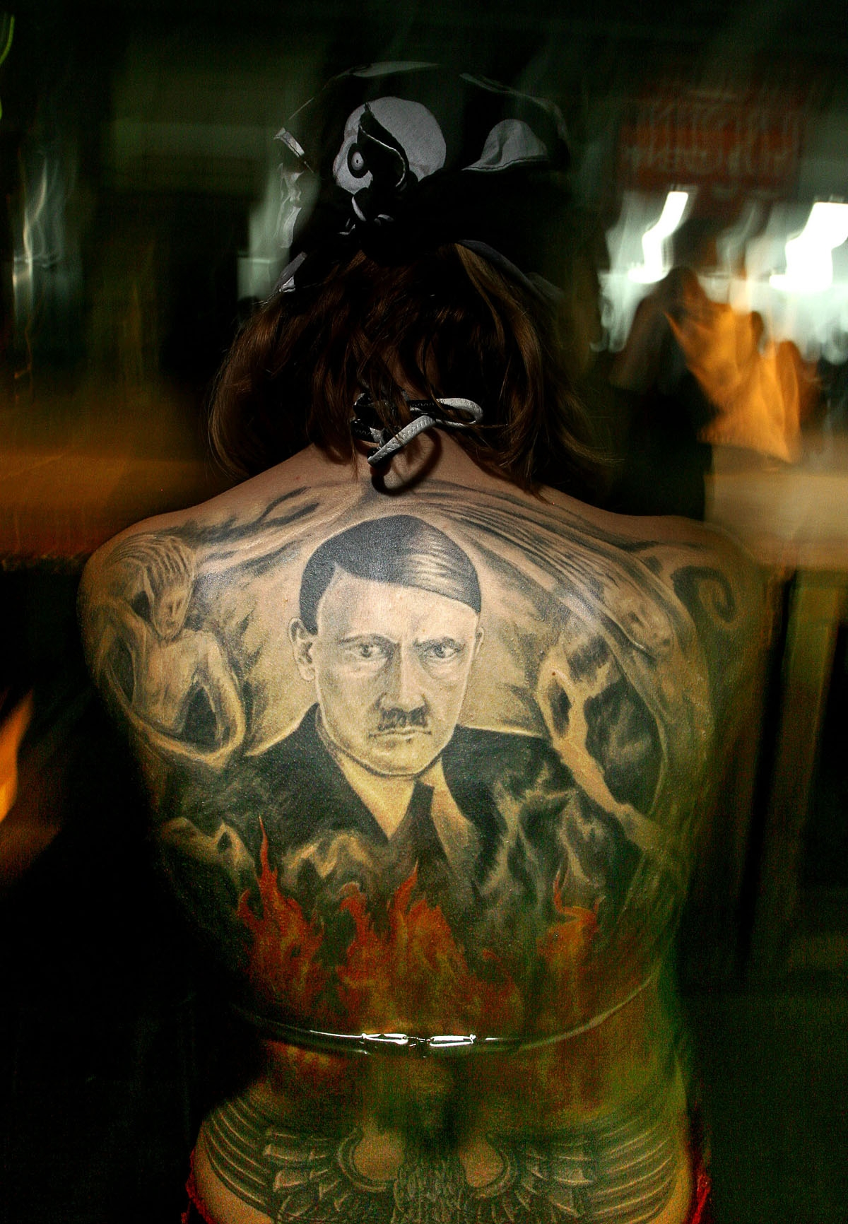 A Bulgarian girl shows off her tattoo representing Adolf Hitler as she takes part in a contest during the annual Tattoo and Piercing festival in Sofia, 08 October 2005.