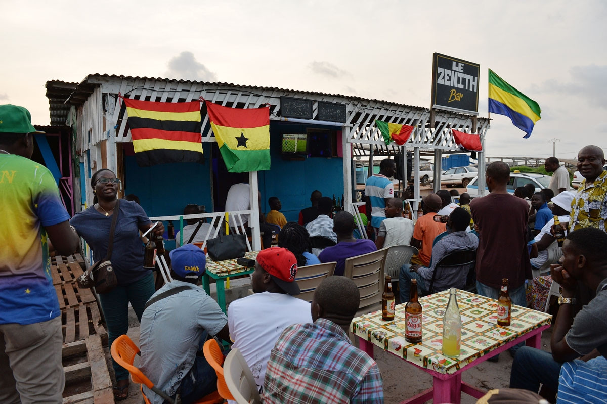 People watch the opening game of the 2017 Africa Cup of Nations football tournament between Gabon and Guinea-Bissau at a bar in Port-Gentil on January 14, 2017.