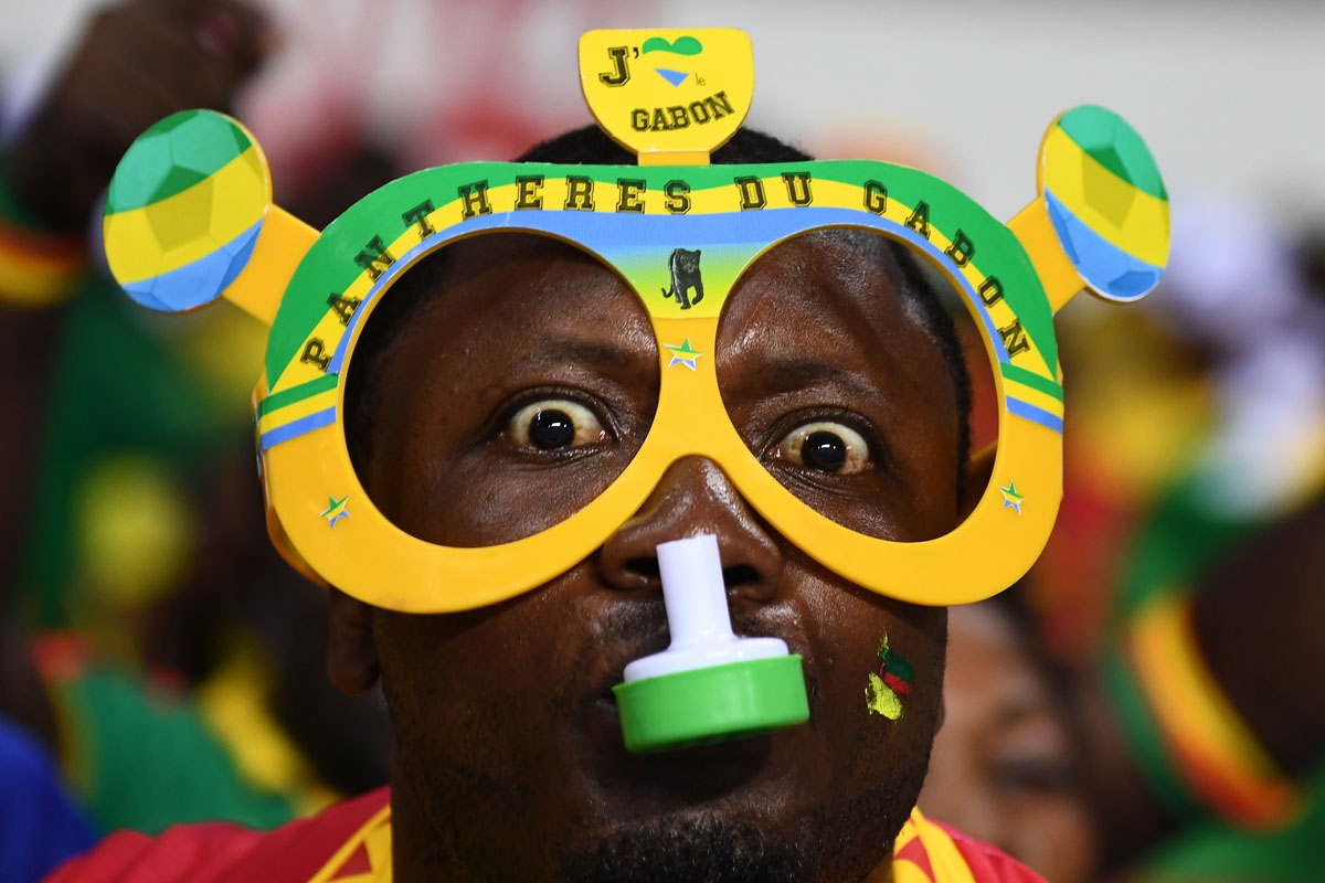 A Gabon supporter blows a whistle ahead of the 2017 Africa Cup of Nations group A football match between Cameroon and Guinea-Bissau at the Stade de l'Amitie Sino-Gabonaise in Libreville on January 18, 20