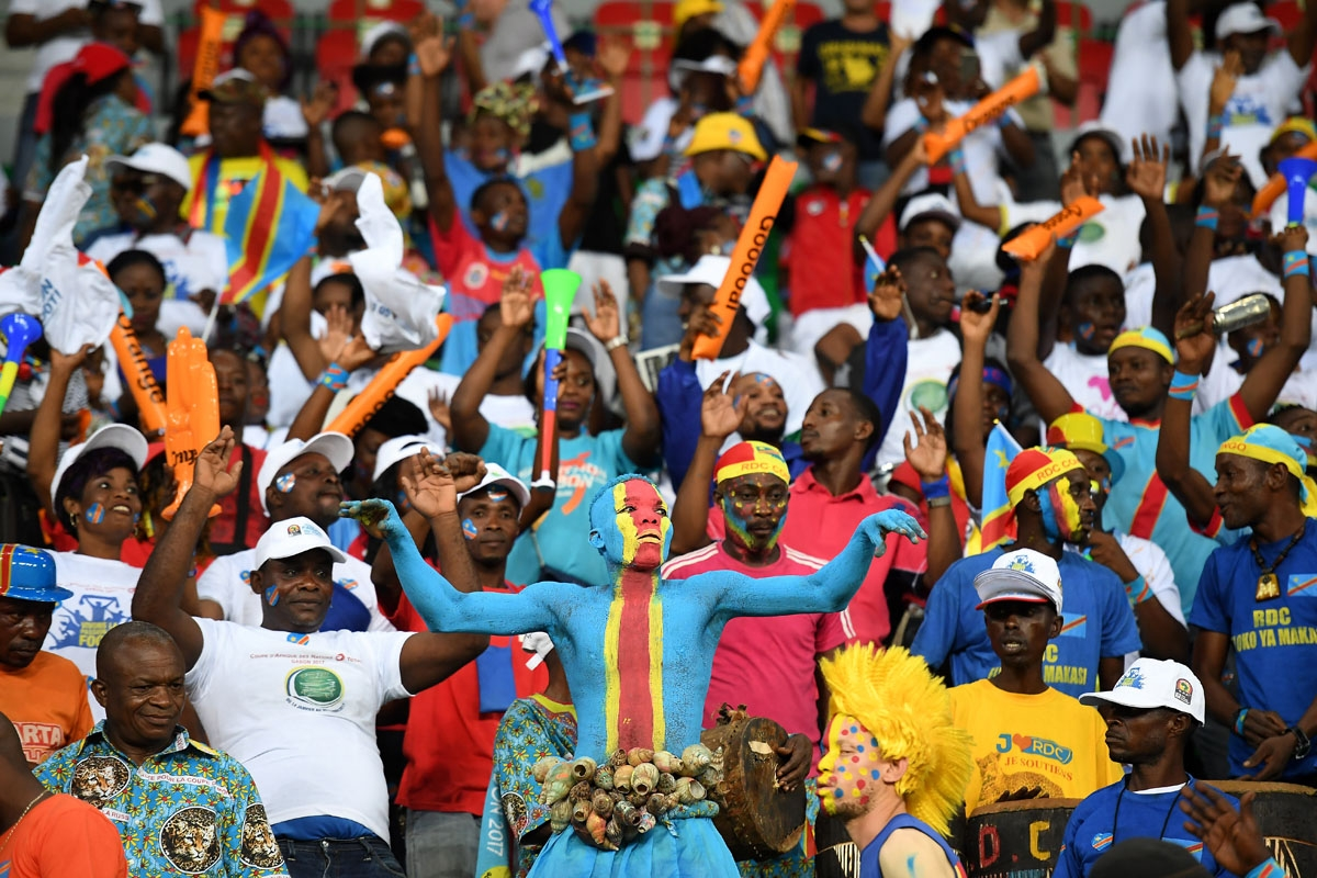 A Democratic Republic of the Congo supporter cheers during the 2017 Africa Cup of Nations group C football match between Togo and DR Congo in Port-Gentil on January 24, 2017.