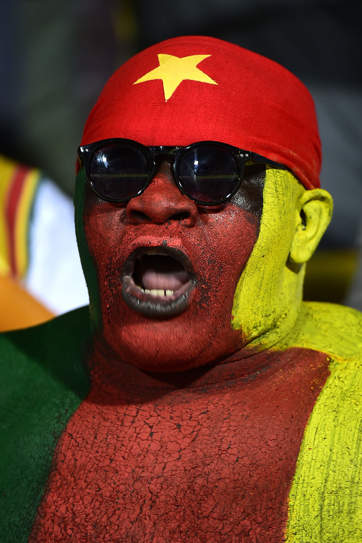 A Cameroon supporter cheers ahead of the 2017 Africa Cup of Nations quarter-final football match between Senegal and Cameroon in Franceville on January 28, 2017.