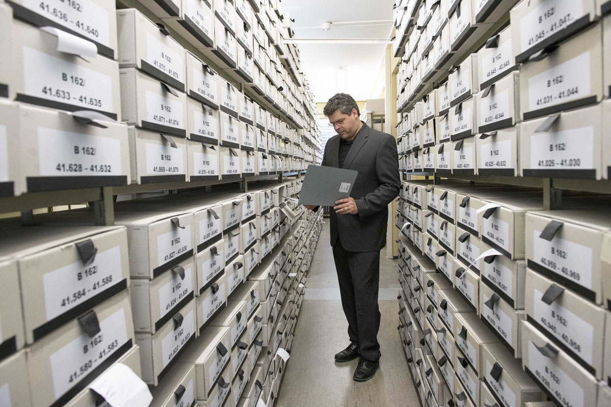 German prosecutor, head of Central Office of the Judicial Authorities of the Federal States for the Investigation of National Socialist Crimes, Jens Rommel stands in the archives room of the institution on April 19, 2018 in Ludwigsburg, southwestern Germa